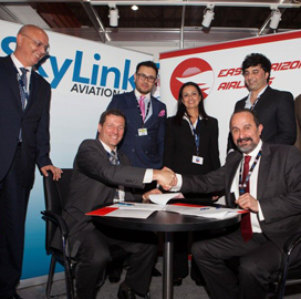 skylink aviation shaking hands