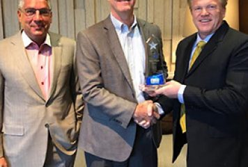 Jim Garrettson presents Terry Hagen with Wash100 award; Steve Demetriou participates