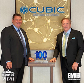 Jim Garrettson, CEO of Executive Mosaic, Presents Mike Twyman, President of Cubic Mission Solutions, His First Wash100 Award